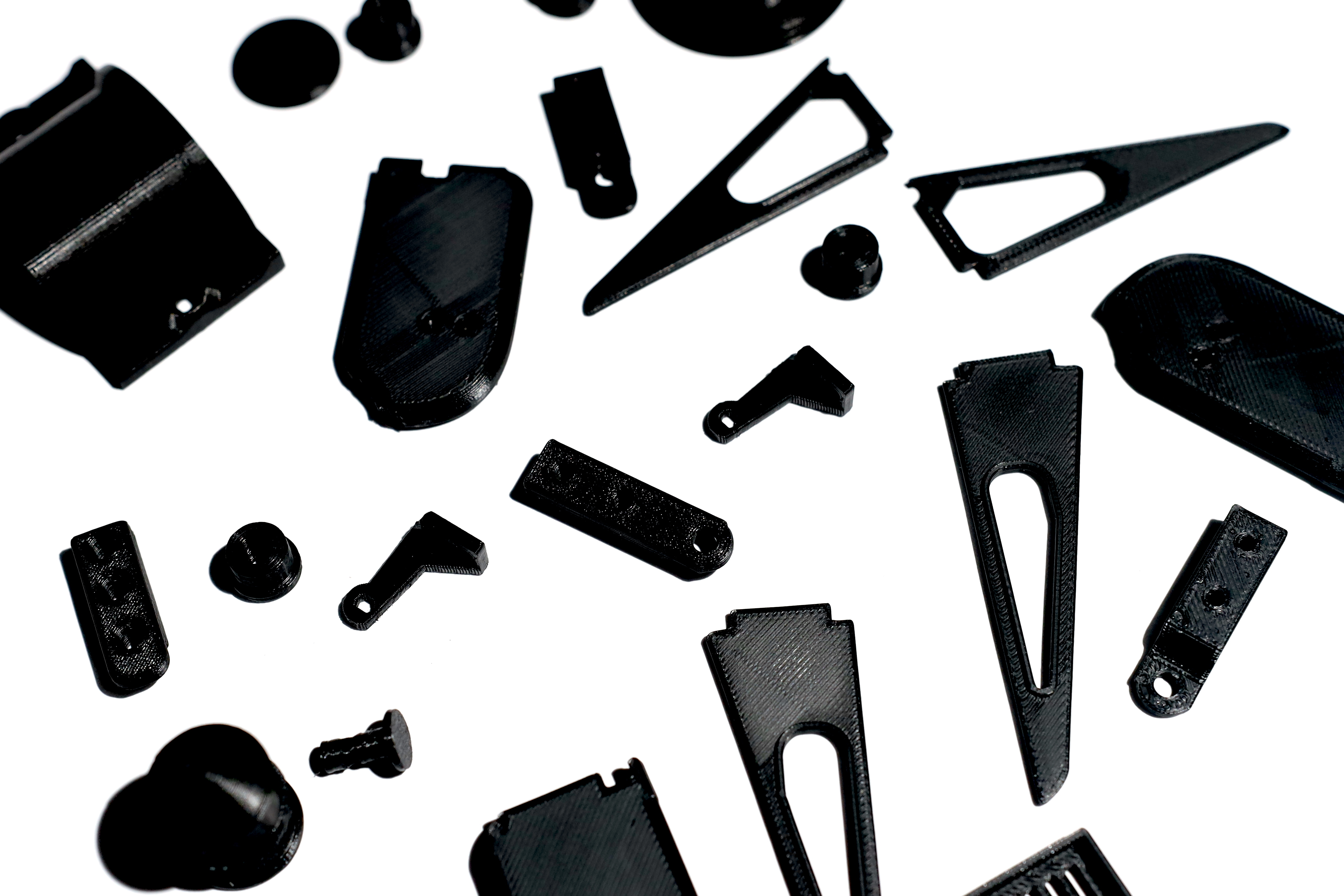 3D Printing Materials - PLA - Makelab - Parts Scattered