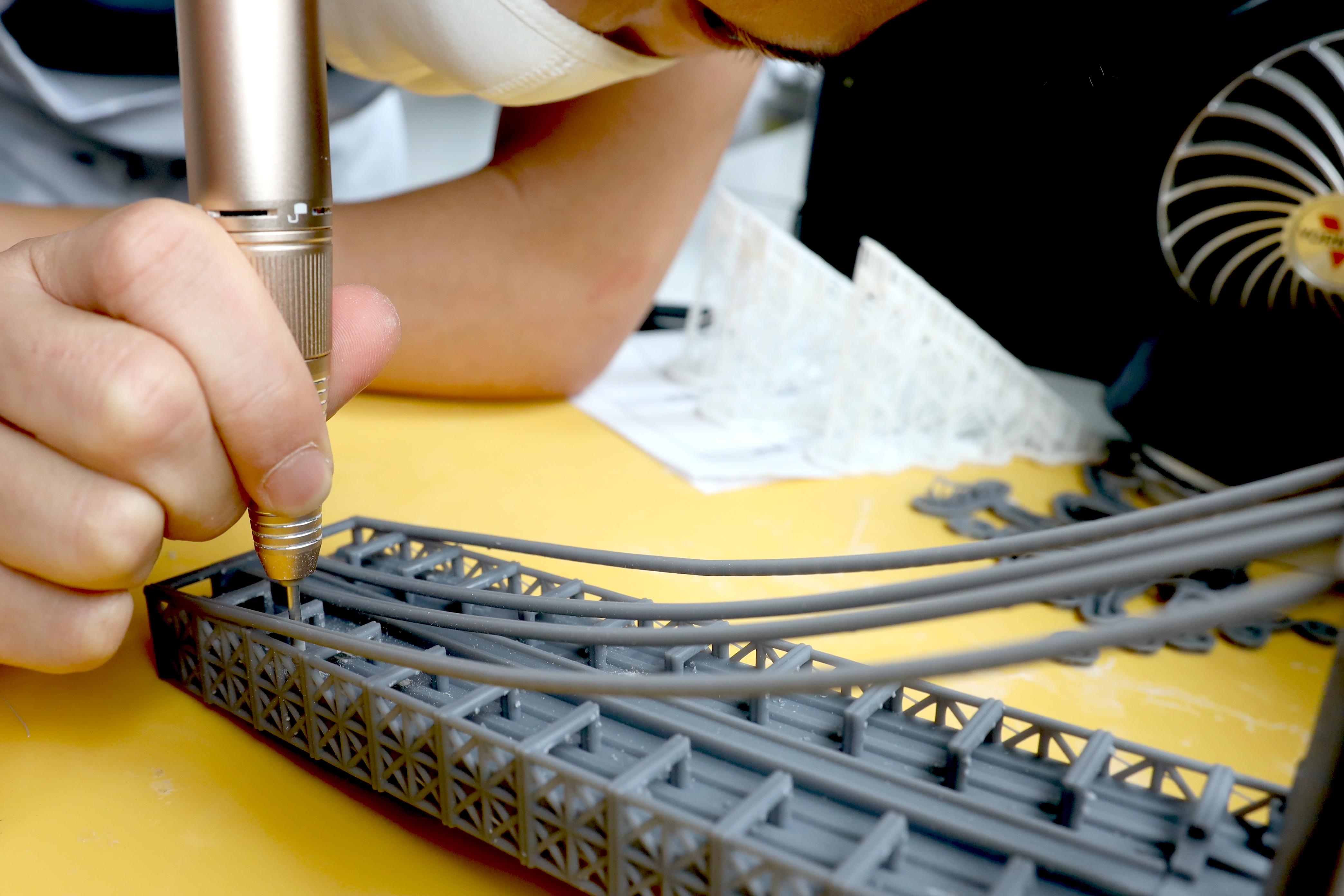 3D Printing Materials - Standard Resin - Makelab - Brooklyn Bridge Model Sanding Dremel
